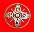 Florin carved into a brooch with initials R M S