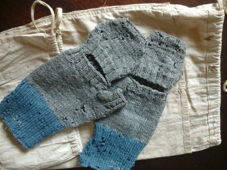 Blue and grey woollen mittens with flour bag