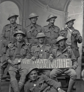 A group of 2nd Division soldiers holding a sign saying WE WANT OUR MUMIE
