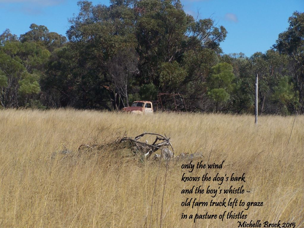 Haiga over picture of farm paddock: only the wind / knows the dog's bark / and the boy's whistle – / old farm truck left to graze / in a pasture of thistles