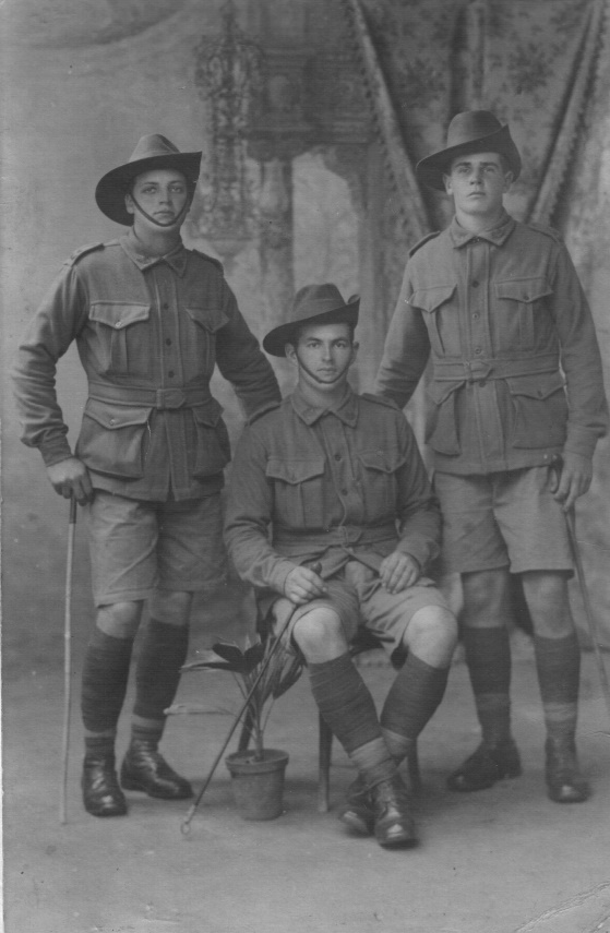 Three friends in uniform posing for camera