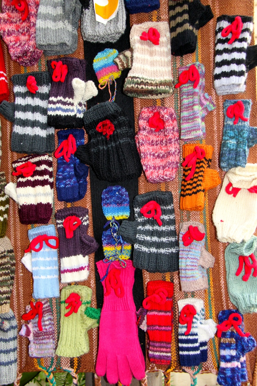 100 pairs of hand-knitted fingerless mittens
